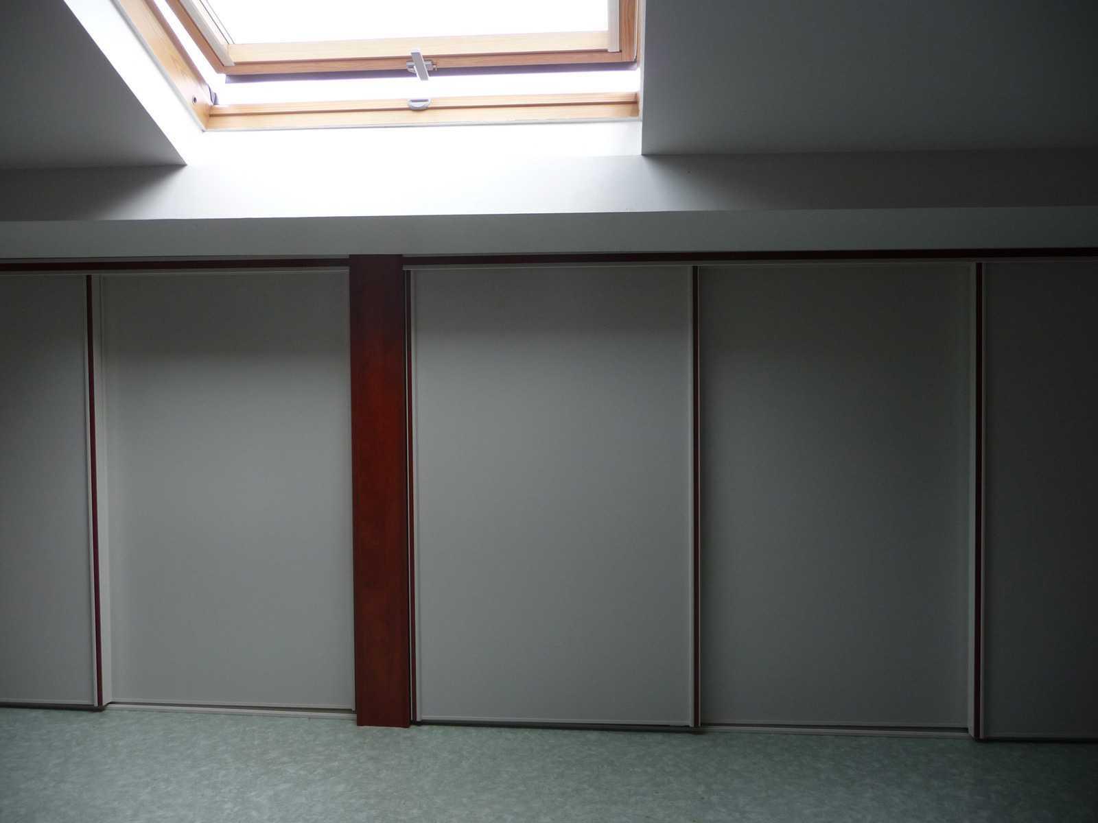 Nos r alisations la maison des bibliotheques for Porte coulissante sous pente laterale